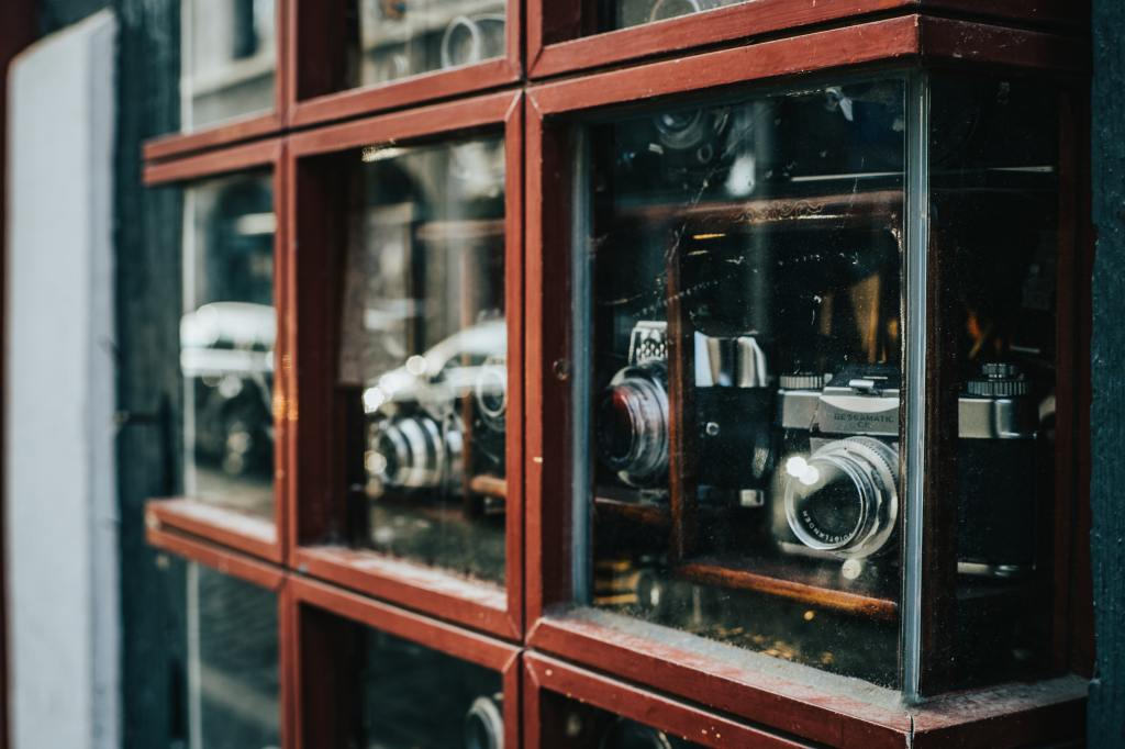 Photo of a shop window with cameras in it.